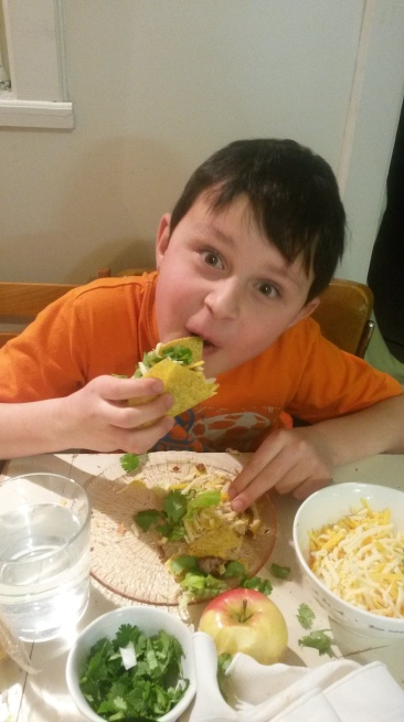 N loving his meaty tacos!