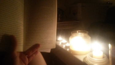 Candlit bookreading in the bathtub
