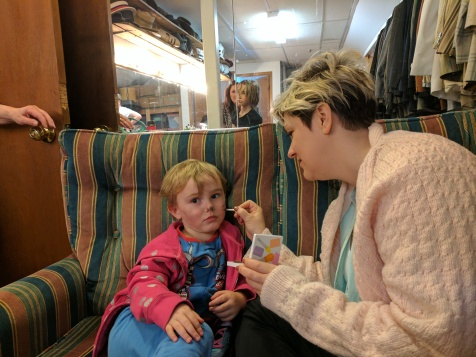 Theatre time! Boy#2 requiring one of our leading ladies to apply his cat whiskers. She ran lines while applying makeup to him, similar to what I do each night, but on a three year old who was not on stage. It was adorable. She was a good sport!
